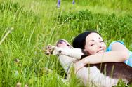 Stock Photo of woman with dog playing in the grass