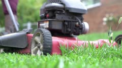 Lawn mower grass shooting out in slow motion Stock Footage