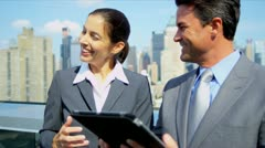 Caucasian managers using internet on touch screen on rooftop   - stock footage