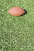 Stock Photo of football laying on grass