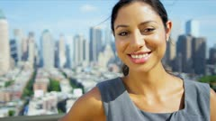 Portrait of beautiful Hispanic manager on rooftop overlooking city   Stock Footage