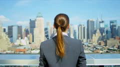 Young Caucasian businesswoman celebrating success on rooftop   - stock footage