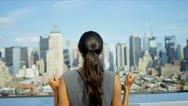 Hispanic businesswoman achieving success on rooftop overlooking Manhattan   Stock Footage