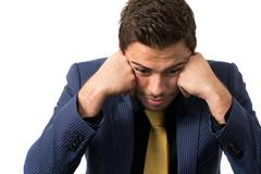 Young stressed overwhelmed businessman Stock Photos