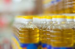 Bottles with sunflower oil on shelves in supermarket Stock Photos
