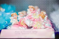 fairy girl candies under shopping window in mall - stock photo