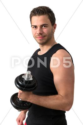 Stock photo of attractive young man working out with weights