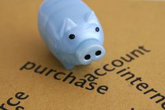 Piggy bank on purchase Stock Photos