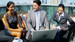 Diverse female and male business colleagues planning outdoors funds on laptop - stock footage
