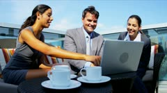Diverse business colleagues planning outdoors funds on laptop computer  - stock footage