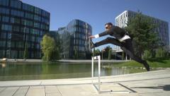 slow motion business hurdler - stock footage