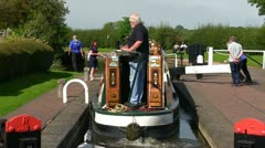 A Canal boat passing through a lock in Wordsley Stock Footage