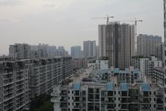Builidings, skyscrapers and cranes in Guangzhou, China. Stock Photos