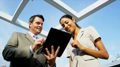 Multi ethnic managers planning investment banking using tablet   - stock footage