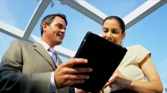 Caucasian business colleagues using touch screen technology  - stock footage