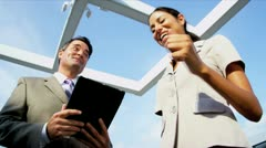 Caucasian businesswoman focusing online on investment banking on city rooftop  - stock footage