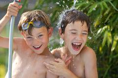 Children playing in the water Stock Photos