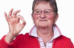 pensioner with sign all okay - stock photo