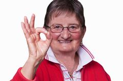 Pensioner with sign all okay Stock Photos