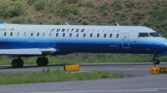 CRJ 700 series jet of United Express at Aspen Airport - 1 Stock Footage