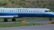 Stock Video Footage of CRJ 700 series jet of United Express at Aspen Airport - 1