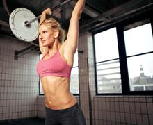 woman lifting weight - stock photo