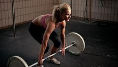 preparing to lift heavy weight bar - stock photo