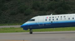 CRJ 700 series jet of United Express at Aspen Airport - 4 Stock Footage