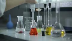 Multicolored liquids and substances in the laboratory 2 - stock footage