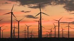 Power Windmills in the California Desert at Sunset Stock Footage