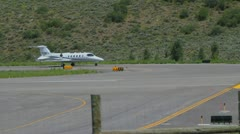 Learjet 31A taxis down runway to takeoff point and flies away - series - 4 Stock Footage