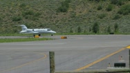 Stock Video Footage of Learjet 31A taxis down runway to takeoff point and flies away - series - 4