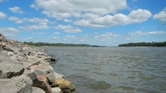 Mississippi River Clouds and Water Lapping Against Rocks - stock footage