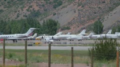 Learjet 31A taxis down runway to takeoff point and flies away - series - 1 Stock Footage