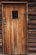 old western jail door - stock photo