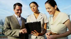 Teamwork of multi ethnic managers discussing finance on touch screen technology  - stock footage