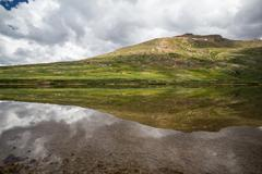 The perfect pond reflection atop of the Continental Divide Stock Photos