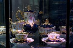 antique porcelain coffee set in show case - stock photo