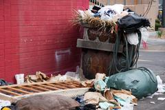 trash dumpster in slums - stock photo