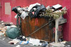 Trash dumpster in slums Stock Photos
