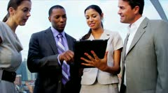 Teamwork of diverse managers planning founds on rooftop New York office  - stock footage