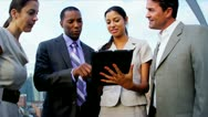 Teamwork of diverse managers planning founds on rooftop New York office  Stock Footage