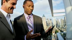 Multi ethnic successful managers working on portfolio online tablet   - stock footage