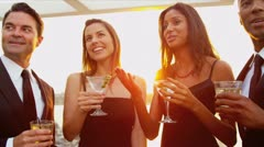 Diverse attractive couples dating at luxury rooftop cocktail party   Stock Footage