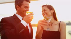 Caucasian couple talking drinking at city cocktail roof party   Stock Footage