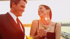 Caucasian friends laughing and drinking cocktails at luxury city sunset party   Stock Footage