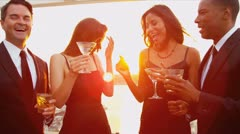 Diverse women and men dating at luxury rooftop party   - stock footage