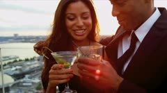 Happy multi ethnic woman and man dating at cocktail party dressed in black  Stock Footage