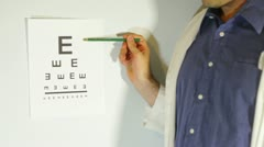 Eye chart optomistrist doctor Stock Footage