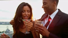 Date of Hispanic woman and African American man at cocktail party   Stock Footage